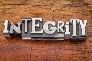 integrity word in metal type