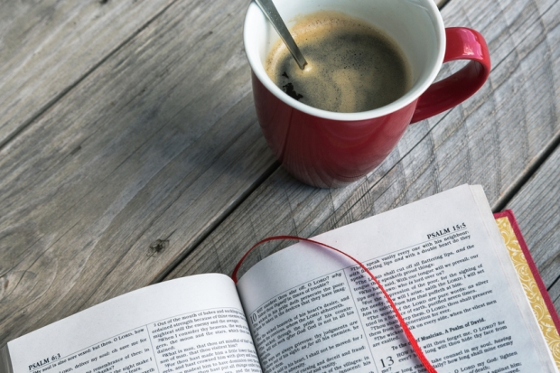 Holy Bible, red cup of coffee