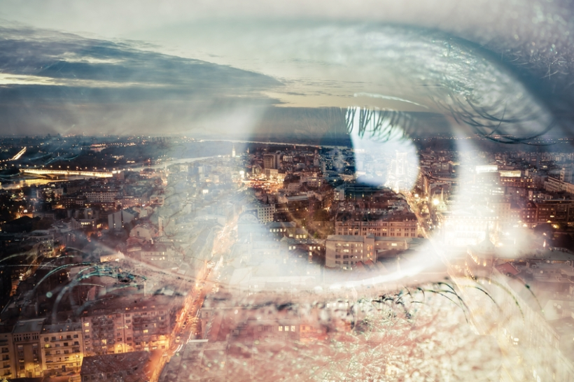 Abstract scene on a female eye and big city.