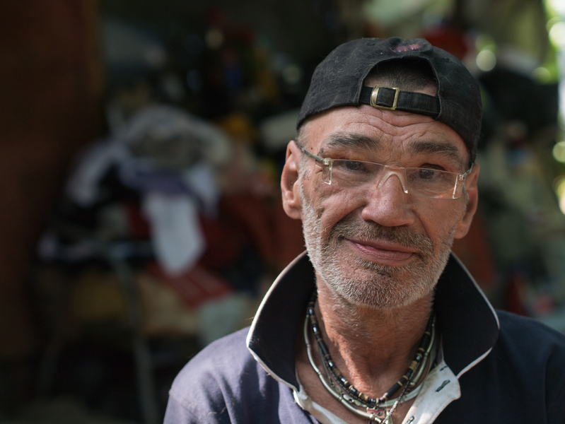 homless man portrait with little smile