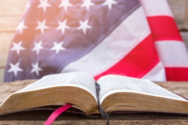 Open book and american flag.