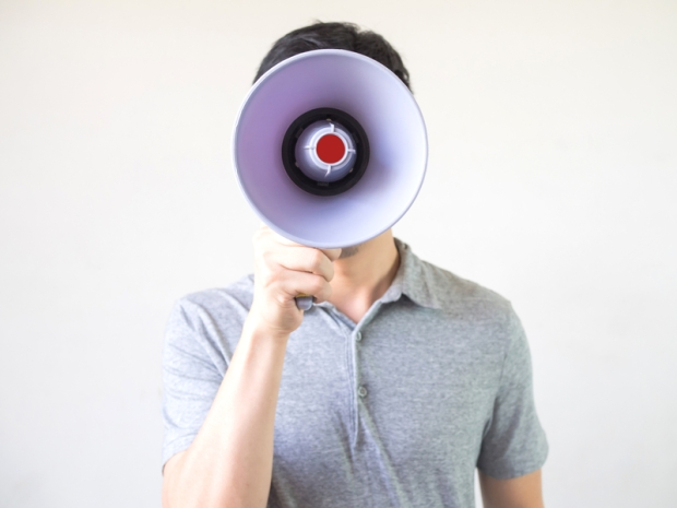 Man with megaphone in hand on the white background