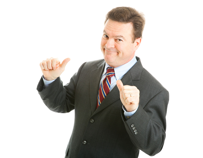 Confident businessman points to himself with both thumbs. Isolated on white.
