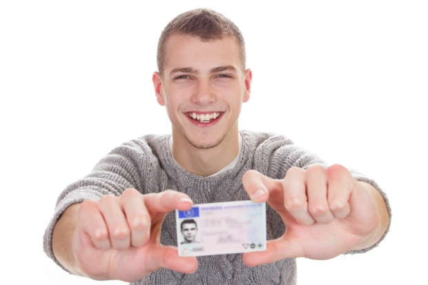 Young man showing his driver license